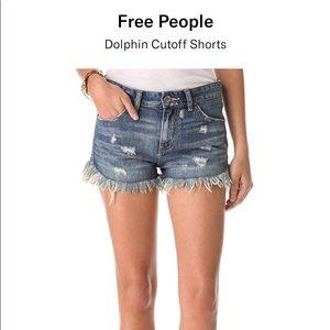 Free People dolphin hem distressed shorts